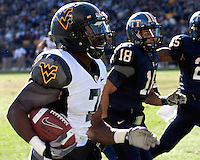 WVU running back Noel Devine heads downfield during a 48-yard catch/run against Pitt. The WVU Mountaineers defeated the Pitt Panthers 35-10 at Heinz Field, Pittsburgh, Pennsylvania on November 26, 2010.