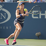 Eugenie Bouchard (CAN) succumbs to the extreme heat in losing to Ekaterina Makarova (RUS) 7-6, 6-4 at the US Open being played at USTA Billie Jean King National Tennis Center in Flushing, NY on September 1, 2014