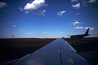 View out of airplane window; other airplane on runway<br />