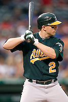 Oakland Athletics shortstop Cliff Pennington (2) at bat against the Texas Rangers in American League baseball on May 11, 2011 at the Rangers Ballpark in Arlington, Texas. (Photo by Andrew Woolley / Four Seam Images)