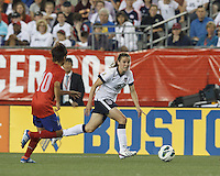 USWNT midfielder Heather O'Reilly (9) dribbles down the wing. In an international friendly, the U.S. Women's National Team (USWNT) (white/blue) defeated Korea Republic (South Korea) (red/blue), 4-1, at Gillette Stadium on June 15, 2013.