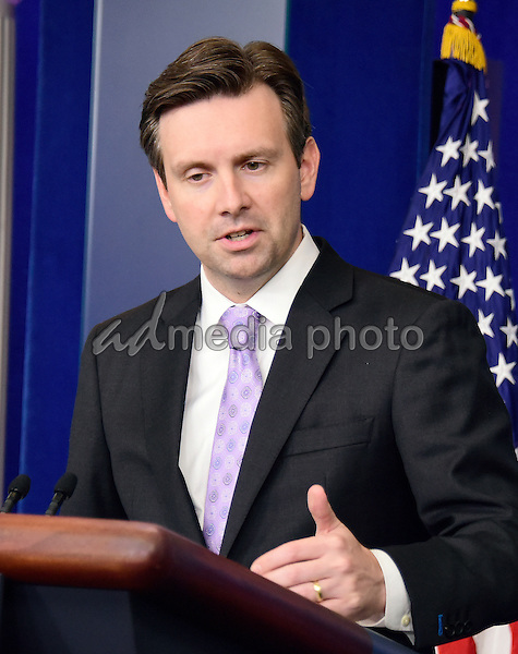 White House Press Secretary Josh Earnest conducts the daily briefing in the Brady Press Briefing Room of the White House in Washington, D.C. on Wednesday, July 8, 2014. Photo Credit: Ron Sachs/CNP/AdMedia
