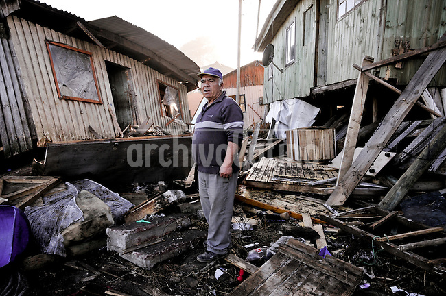 Chile, Aftermath of the tsunami in the area of Consitucion. Fisherman outside his house.