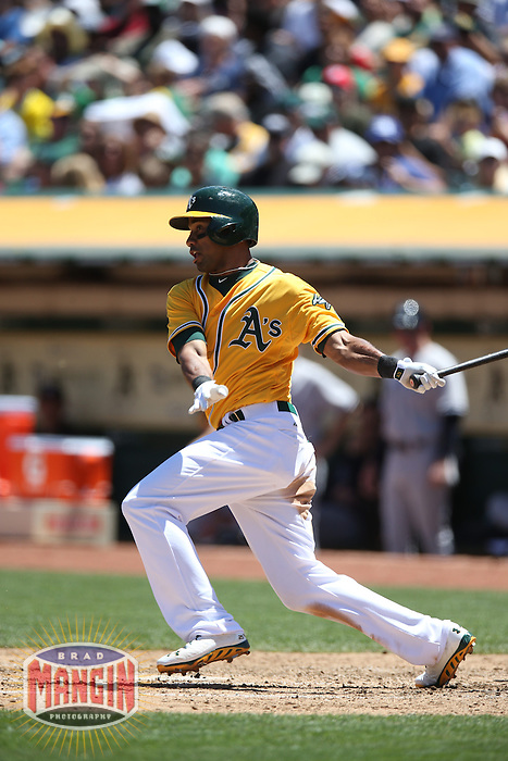 OAKLAND, CA - JUNE 13:  Chris Young #25 of the Oakland Athletics bats against the New York Yankees during the game at O.co Coliseum on Thursday June 13, 2013 in Oakland, California. Photo by Brad Mangin