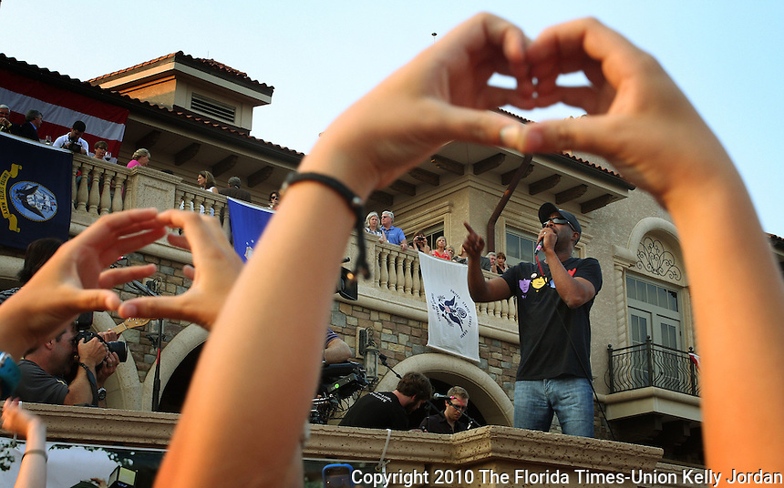 KELLY JORDAN/The Times-Union--051111--Fans hold their hands in the shape of a heart as they enjoy the Daius Rucker concert as fans enjoy Military Appreciation Day at The Players Championship Tuesday May 11, 011. Thousands of people came out to enjoy the ceremony and concert and to celebrate the military.(The Florida Times-Union, Kelly Jordan)