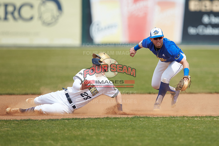 Nick Melton (28) of the Queens Royals is tagged out by Paul Martin (14) of the Mars Hill Lions as he tries to steal second base at Intimidators Stadium on March 30, 2019 in Kannapolis, North Carolina. The Royals defeated the Bulldogs 11-6 in game one of a double-header. (Brian Westerholt/Four Seam Images)
