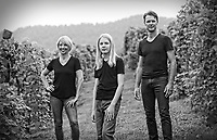 Winemaker Riann Rossouw, hi s wife Rachel O'Neill and their son Joshua pose among the vines used to make R wine. Photo/Andrew Shurtleff Photography, LLC