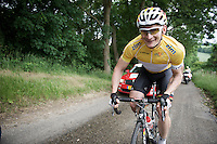 André Greipel (DEU/Lotto-Soudal) in the leaders jersey,  returning with a smile to the peloton up a climb after a nature break<br /> <br /> stage 3: Buchten-Buchten (190km)<br /> 29th Ster ZLM Tour 2015