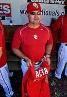 23 September 2007: Washington Nationals Manager Manny Acta removed his game jersey preparing for a post-game ceremony commemorating the last professional baseball game played at Robert F. Kennedy Memorial Stadium in Washington, DC. The Nationals defeated the visiting Philadelphia Phillies 5-3 to close out the 2007 season at RFK Stadium.. .Mandatory Photo Credit: Ed Wolfstein Photo