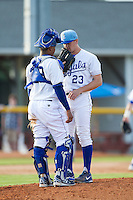 Burlington Royals catcher Meibrys Viloria (29) has a chat on the mound with relief pitcher Ian Tompkins (23) during the game against the Greeneville Astros at Burlington Athletic Park on June 29, 2014 in Burlington, North Carolina.  The Royals defeated the Astros 11-0. (Brian Westerholt/Four Seam Images)