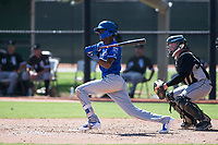 Kansas City Royals shortstop Maikel Garcia (4) follows through on his swing in front of catcher Evan Skoug (27) during an Instructional League game against the Chicago White Sox at Camelback Ranch on September 25, 2018 in Glendale, Arizona. (Zachary Lucy/Four Seam Images)