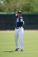 San Diego Padres outfielder Tre Carter (13) warms up in the outfield between innings during an Instructional League game against the Chicago White Sox on September 26, 2017 at Camelback Ranch in Glendale, Arizona. (Zachary Lucy/Four Seam Images)