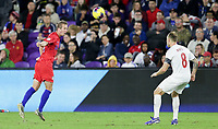 ORLANDO, FL - NOVEMBER 15: Jackson Yueill #14 of the United States heads a ball during a game between Canada and USMNT at Exploria Stadium on November 15, 2019 in Orlando, Florida.