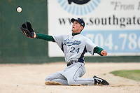 Left fielder Jacob Goebbert #24 of the Lexington Legends makes a sliding attempt to catch this foul fly ball at Fieldcrest Cannon Stadium April 14, 2010, in Kannapolis, North Carolina.  Photo by Brian Westerholt / Four Seam Images