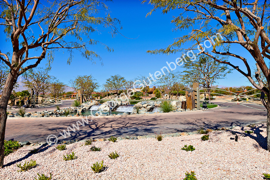 Water feature by access gate to gated community