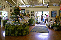 Tropical Farms Macadamia Nut Farm outlet. Besides  offering delicious macadamia nuts for traveling shoppers,there is a tropical garden and a deck overlooking an ancient hawaiian fishing pond on the grounds.Located near Kualoa Ranch, east oahu.