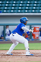 AZL Cubs second baseman Yonathan Perlaza (15) squares to bunt against the AZL Rangers on July 24, 2017 at Sloan Park in Mesa, Arizona. AZL Cubs defeated the AZL Rangers 2-1. (Zachary Lucy/Four Seam Images)