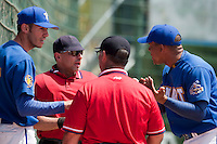 24 May 2009: Home plate umpire Franck Benasseur talks to Matthieu Brelle Andrade and Ernesto Martinez during the 2009 challenge de France, a tournament with the best French baseball teams - all eight elite league clubs - to determine a spot in the European Cup next year, at Montpellier, France. Senart wins 8-5 over La Guerche.