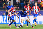 Shinji Okazaki (2nd from left) of Leicester City fights for the ball with Saul Niguez Esclapez (l) of Atletico de Madrid during their 2016-17 UEFA Champions League Quarter-Finals 1st leg match between Atletico de Madrid and Leicester City at the Estadio Vicente Calderon on 12 April 2017 in Madrid, Spain. Photo by Diego Gonzalez Souto / Power Sport Images