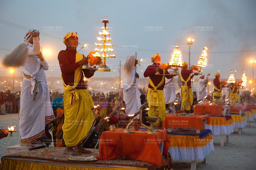 India. Uttar Pradesh state. Allahabad. Maha Kumbh Mela. Ganga Aarti ceremony at night. Ganga Aarti (also spelled arathi, aarthi) is a Hindu religious ritual of worship, a part of puja, in which light from wicks soaked in ghee (purified butter) or camphor is offered to one or more deities. The Kumbh Mela, believed to be the largest religious gathering is held every 12 years on the banks of the 'Sangam'- the confluence of the holy rivers Ganga, Yamuna and the mythical Saraswati. The Maha (great) Kumbh Mela, which comes after 12 Purna Kumbh Mela, or 144 years, is always held at Allahabad. Uttar Pradesh (abbreviated U.P.) is a state located in northern India. 19.02.13 © 2013 Didier Ruef