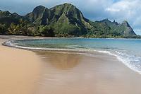 The view while walking the shore at Tunnels Beach, Ha'ena, Kaua'i; Mount Makana (nicknamed Bali Hai) is on the right of the mountain range.