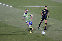 COLUMBUS, OH - DECEMBER 12: Jordan Morris #13 of the Seattle Sounders FC plays the ball past Artur #8 of the Columbus Crew during a game between Seattle Sounders FC and Columbus Crew at MAPFRE Stadium on December 12, 2020 in Columbus, Ohio.