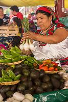 Tlacolula; Oaxaca; Mexico; North America.  Zapotec Indian Vegetable Vendor, Tlacolula Market.