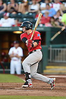 Frisco Rough Riders third baseman Ryan Rua (9) at bat during a game against the Springfield Cardinals on June 1, 2014 at Hammons Field in Springfield, Missouri.  Springfield defeated Frisco 3-2.  (Mike Janes/Four Seam Images)