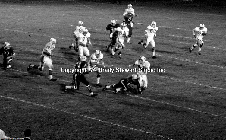 Bethel Park PA:   A 4th-down defensive stop with Mike Stewart 11, Clark Miller 30, and Dennis Franks 66 making the play for no gain.  The offense and defense played very well in the  14-0 victory over Canon McMillan. Others in the photo; Chip Huggins 32, Bruce Evanovich 80, Vic Tedesco 61, Jim Dingeldine 73, Dan Hannigan 64. The defensive unit was one of the best in Bethel Park history only allowing a little over 7 points a game.