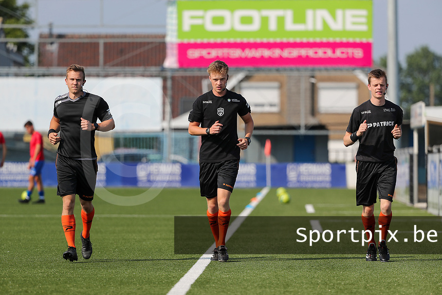 assistant referee Tim Rasschaert , referee Cis Bellon and assistant referee Jonas Van Dyck pictured warming up before a friendly soccer game between K Londerzeel SK and RSC Anderlecht Reserves during the preparations for the 2021-2022 season , on Wednesday 21st of July 2021 in Londerzeel , Belgium . PHOTO SEVIL OKTEM | SPORTPIX