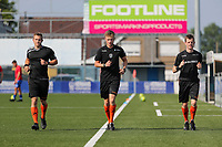assistant referee Tim Rasschaert , referee Cis Bellon and assistant referee Jonas Van Dyck pictured warming up before a friendly soccer game between K Londerzeel SK and RSC Anderlecht Reserves during the preparations for the 2021-2022 season , on Wednesday 21st of July 2021 in Londerzeel , Belgium . PHOTO SEVIL OKTEM   SPORTPIX
