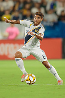 CARSON, CA - SEPTEMBER 15: Jonathan dos Santos #8 of the Los Angeles Galaxy moves with the ball during a game between Sporting Kansas City and Los Angeles Galaxy at Dignity Health Sports Complex on September 15, 2019 in Carson, California.