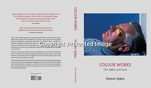 Colour Works: The 1980s and 90s. Published by Dewi Lewis Publishing in June/ July 2021.<br /> Blackpool, Lancashire. 1980's<br /> With orange peel eye protectors an older man enjoys an afternoon sunbathing .
