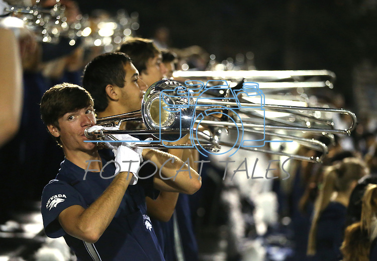 The Nevada Marching Band performs during an NCAA college football game against Arizona in Reno, Nev., on Saturday, Sept. 12, 2015. (AP Photo/Cathleen Allison)
