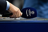 A journalist holds a microphone with the Champions league logo during the Uefa Champions League group D football match between FC Internazionale and Real Madrid at San Siro stadium in Milano (Italy), September 15th, 2021. Photo Andrea Staccioli / Insidefoto