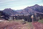 MAN HIKES MOUNTAIN TRAIL