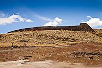 A family nearing Pu'ukohola Heiau (a.k.a. the temple on the whale hill), the largest and last heiau constructed in 1790-91 by Kamehameha I, Pu'ukohola Heiau National Historic Site, Kawaihae, Kohala, Big Island.