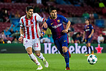 Luis Alberto Suarez Diaz (r) of FC Barcelona fights for the ball with Dimitris Nikolaou of Olympiacos FC during the UEFA Champions League 2017-18 match between FC Barcelona and Olympiacos FC at Camp Nou on 18 October 2017 in Barcelona, Spain. Photo by Vicens Gimenez / Power Sport Images