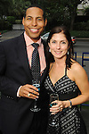 Bryce Kennard and Amber Winsor at the Champagne & Ribs event at the Contemporary Arts Museum Thursday May 13,2010.  (Dave Rossman Photo)