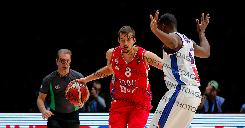France's Florent Pietrus (R) vies with Serbia's Nemanja Bjelica (L) during European championship basketball match for third place between France and Serbia on September 20, 2015 in Lille, France  (credit image & photo: Pedja Milosavljevic / STARSPORT)