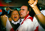English football fans World Cup 1998. Supporters showing emotions watching a penalty shoot out between England and Argentina that decided the game, Argentina won 4–3 after two English kicks were saved. England was  knocked out of the World Cup. Watching on a multi screens in a television room of the Sports Bar, London 1990s UK
