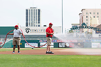 A groundskeeper waters the field before a game between the Fresno Grizzlies and the Reno Aces at Chukchansi Park on April 8, 2019 in Fresno, California. (Zachary Lucy/Four Seam Images)