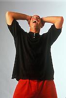 Ecstatic man laughing.
