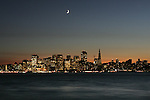 The crescent Moon sits high above the San Francisco skyline as seen from treasure Island....