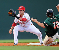 August 13, 2009: Shortstop Casey Kelly (23) of the Greenville Drive prepares tag to Daniel Pertusati (12) of the Greensboro Grasshoppers who is attempting to steal during a game at Fluor Field at the West End in Greenville, S.C. Photo by: Tom Priddy/Four Seam Images