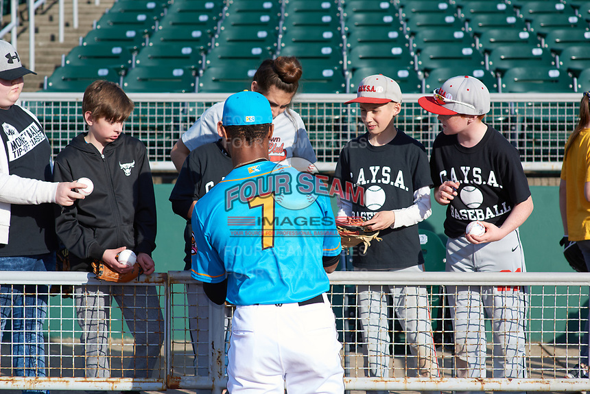 Lansing Lugnuts DJ Neal (7) signs autographs before a Midwest League game against the Beloit Snappers at Cooley Law School Stadium on May 4, 2019 in Lansing, Michigan. The Lugnuts wore their Copa de la Diversión jerseys, becoming the Lansing Locos for the evening. Beloit defeated Lansing 2-1. (Zachary Lucy/Four Seam Images)