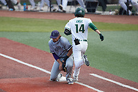 Old Dominion Monarchs first baseman Matt Coutney (21) fields a low throw as Austin Knight (14) of the Charlotte 49ers hustles down the line at Hayes Stadium on April 23, 2021 in Charlotte, North Carolina. (Brian Westerholt/Four Seam Images)