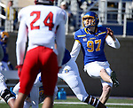BROOKINGS, SD - MARCH 13: Cole Frahm #97 of the South Dakota State Jackrabbits knocks though a field goal against the Youngstown State Penguins at Dana J. Dykhouse Stadium on March 13, 2021 in Brookings, South Dakota. (Photo by Dave Eggen/Inertia)