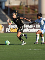 Leslie Osborne (left) keeps the ball away from Chioma Igwe (right) FC Gold Pride tied the Chicago Red Stars 1-1 at Buck Shaw Stadium in Santa Clara, California on June 7th, 2009.
