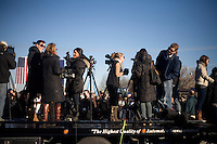 """Members of the media prepare for a speech by Republican presidential candidate Mitt Romney, former governor of Massachusetts, at a rally in Manchester, New Hampshire, on Sat. Dec. 3, 2011. The rally was called, """"Earn It with Mitt,"""" and was designed to bolster local efforts to help Romney """"earn"""" voters' support for the upcoming Republican primary."""